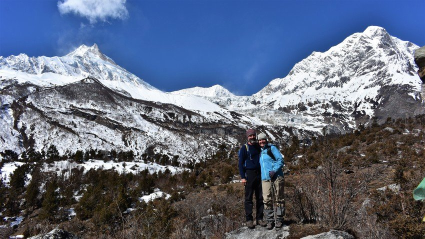 Mount Manaslu and trekkers on the way to Base Camp